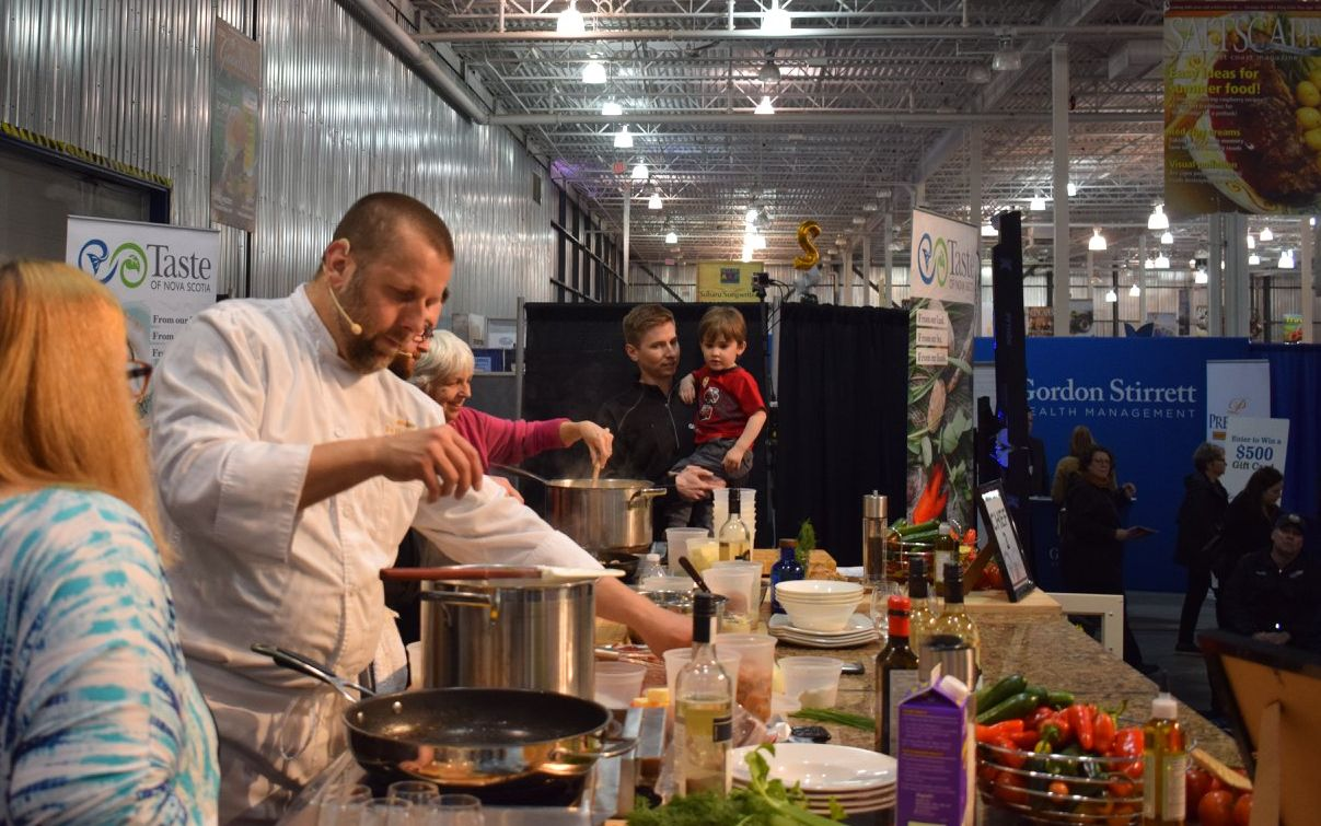 Fox Harb'r Resort Chef Shane Robilliard making chowder on the Taste of Nova Scotia stage Saltscapes Expo